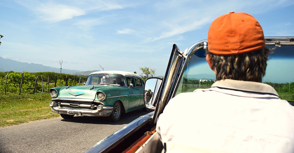 Havana, Cuba, UNESCO World Heritage Site; August, 2016: Driver leaving Old Havana and heading to the city of Trinidad.