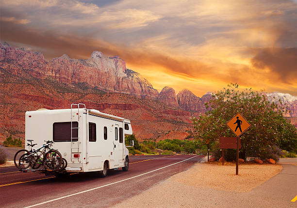 Road trip - Motor home Motor home on the road,  touring Utah, USA motor home stock pictures, royalty-free photos & images