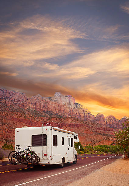Road trip - Motor home Motor home on the road,  touring Utah, USA zion national park stock pictures, royalty-free photos & images