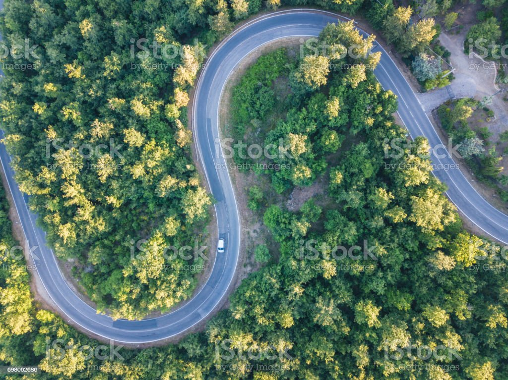 Road trip through a forest - Aerial point of view stock photo