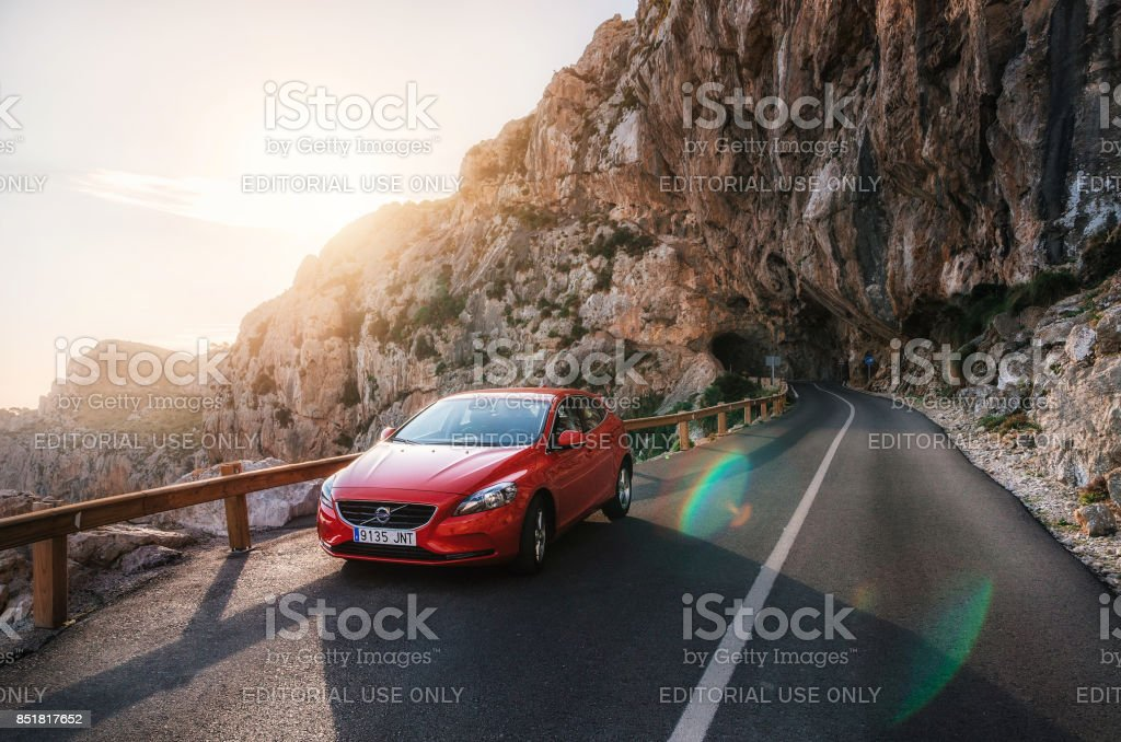 Road trip to mountain with Red car Volvo, Mallorca, Spain stock photo