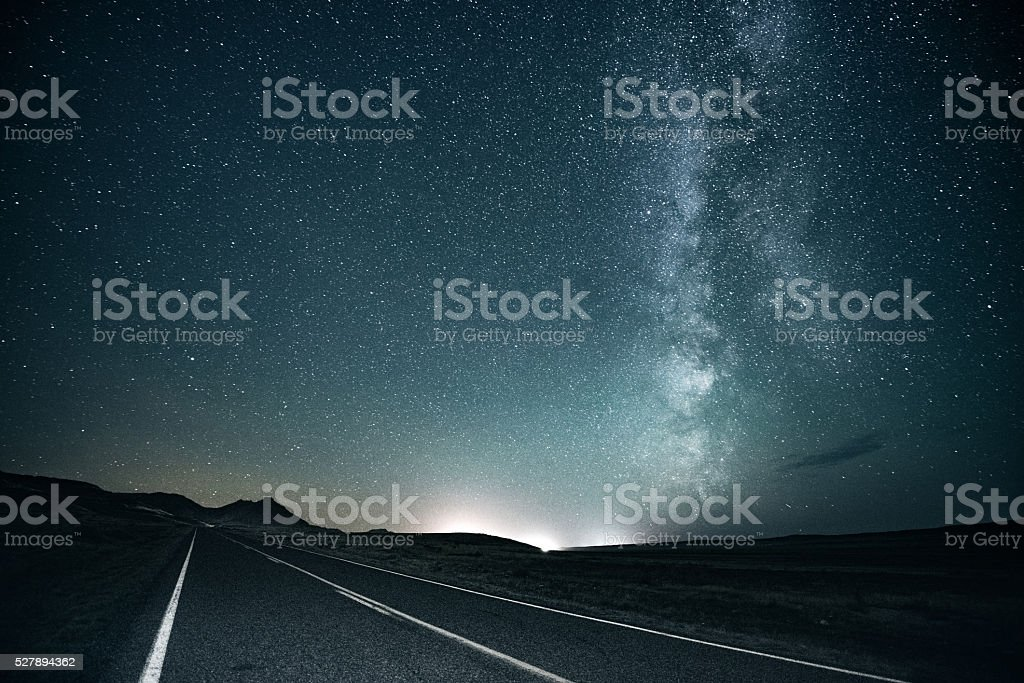Road trip under the milky way stock photo