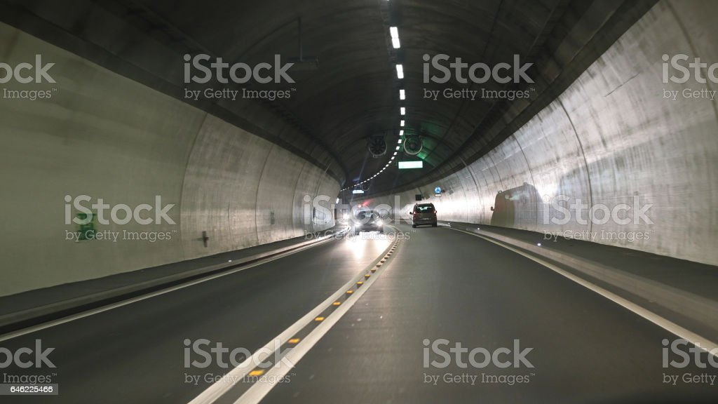 Road tunnel with cars stock photo