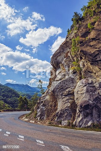 Road Turn Along Steep Rocky Cliff Stock Photo & More Pictures of Adventure