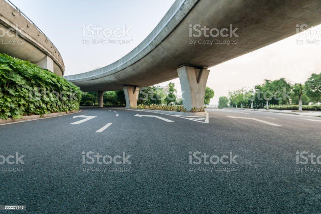 road under bridge stock photo