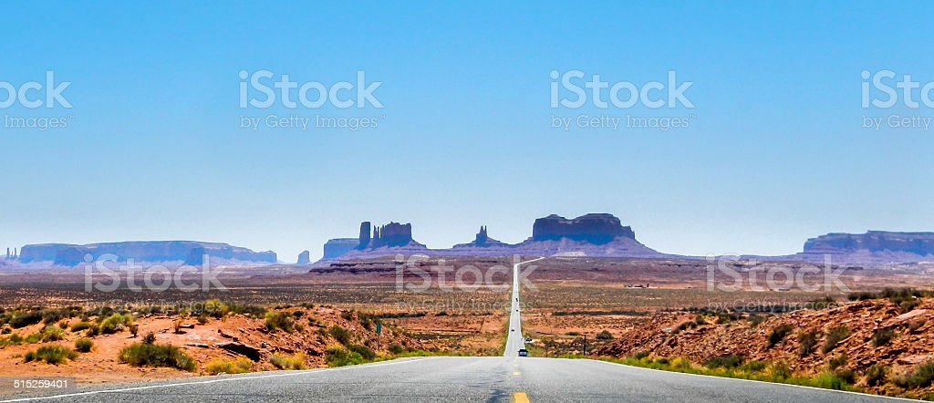 Low shot from the road looking towards Monument Valley