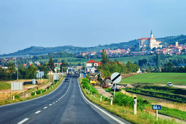 Road view with Mikulov Castle in South Moravia Road view with Mikulov Castle in South Moravia, in Czech Republic. moravia stock pictures, royalty-free photos & images