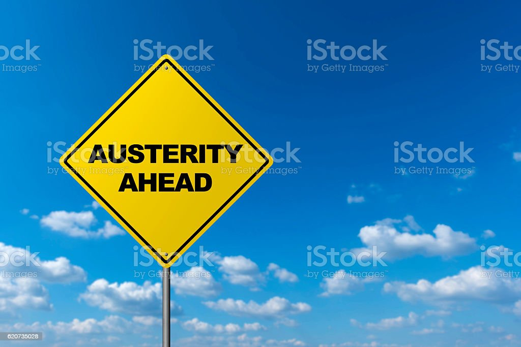 AUSTERITY AHEAD - Road Warning Sign stock photo