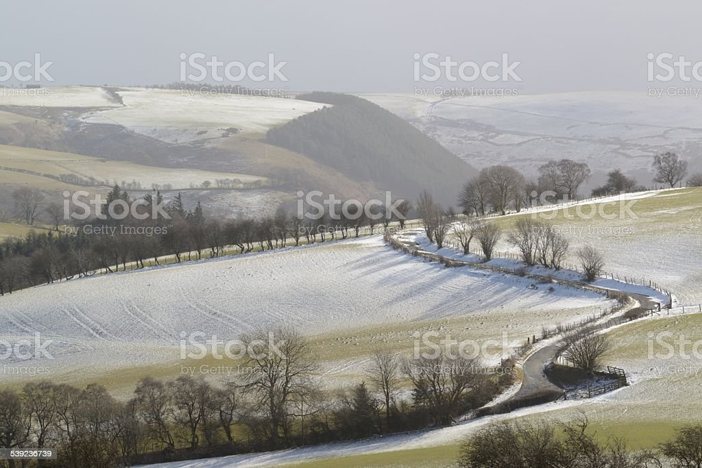 Road winding above the Ceriog Valley in winter royalty-free stock photo