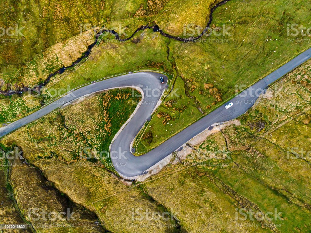 Road winding in Connemara region in Ireland. Scenic Irish countryside...