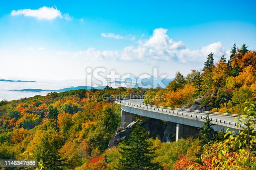Beautiful mountain autumn  landscape with clouds over the beautiful mountains. Linn Cove Viaduct. Close to Blowing Rock, Blue Ridge Parkway, North Carolina, USA.