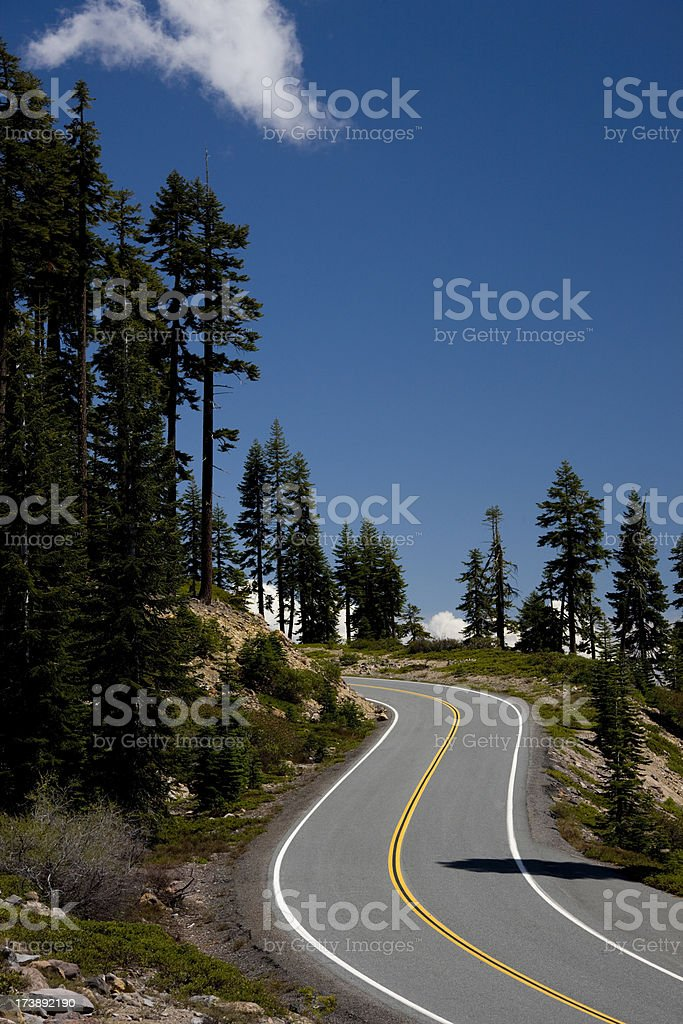 Road winding through forest covered mountains royalty-free stock photo
