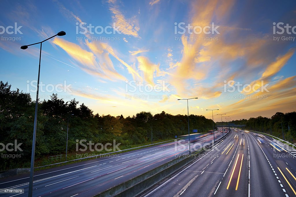 A road with a beautiful sunset off in the distance  royalty-free stock photo