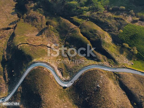 istock Road with curves from above 668047484