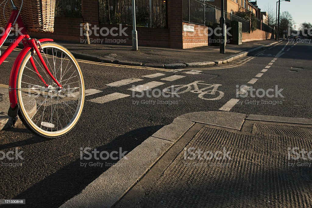 Road with cycle path and bicycle stock photo