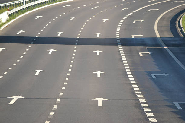 Road with four lanes stock photo