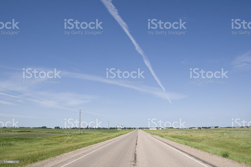 road with jet trail in sky royalty-free stock photo