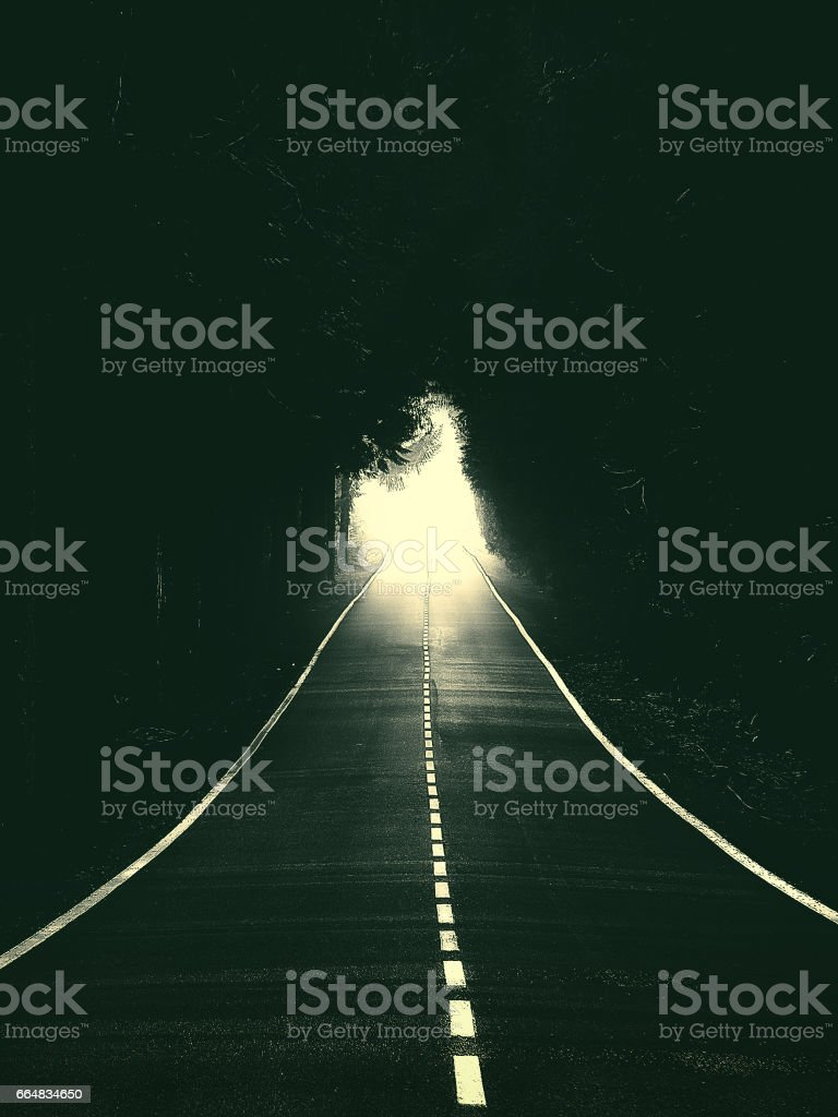 road with light at the end stock photo