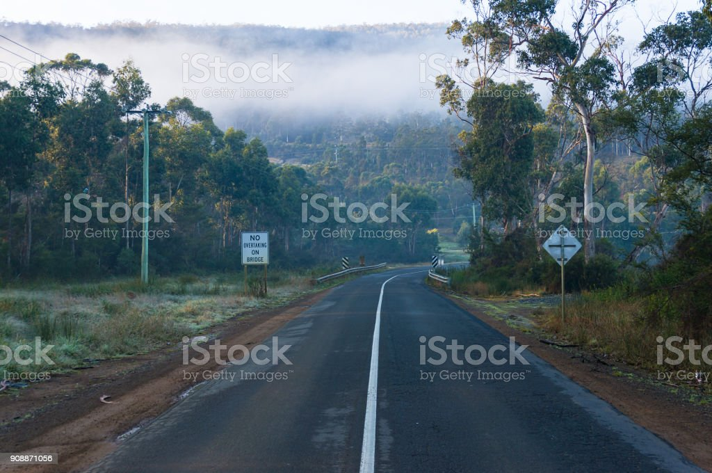 Road with No overtaking road sign stock photo