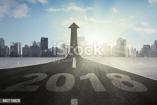 istock Road with numbers 2018 toward an upward arrow 892716828