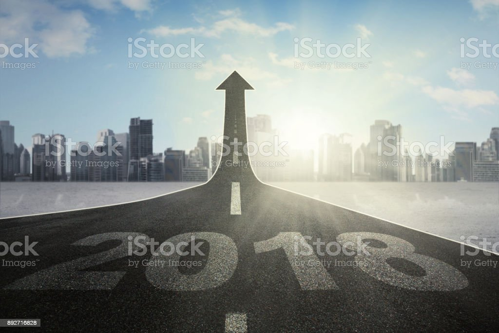 Road with numbers 2018 toward an upward arrow stock photo