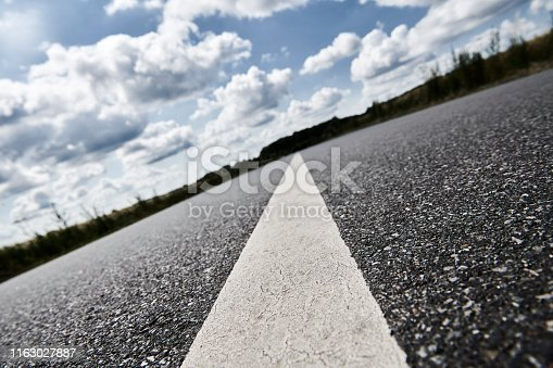 Asphalt road in the countryside. Diminishing perspective and road with dividing line