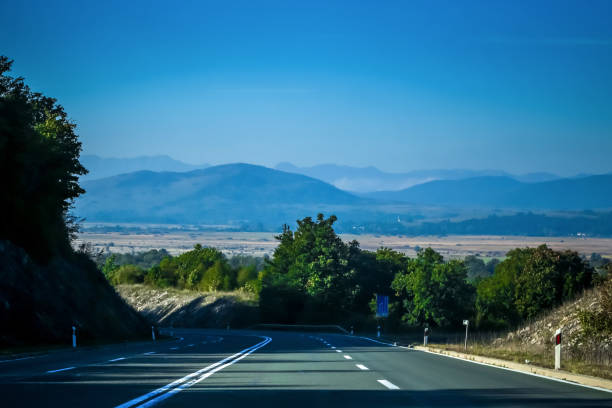 Road with traffic and landscape stock photo