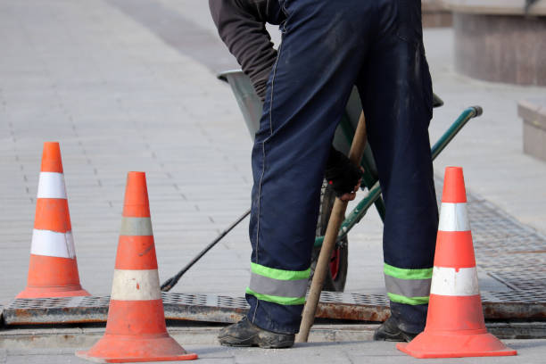 road work and construction, the worker of municipal services repairs drainage system - pedone ruolo dell'uomo foto e immagini stock