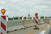 Road work. Orange warning sign