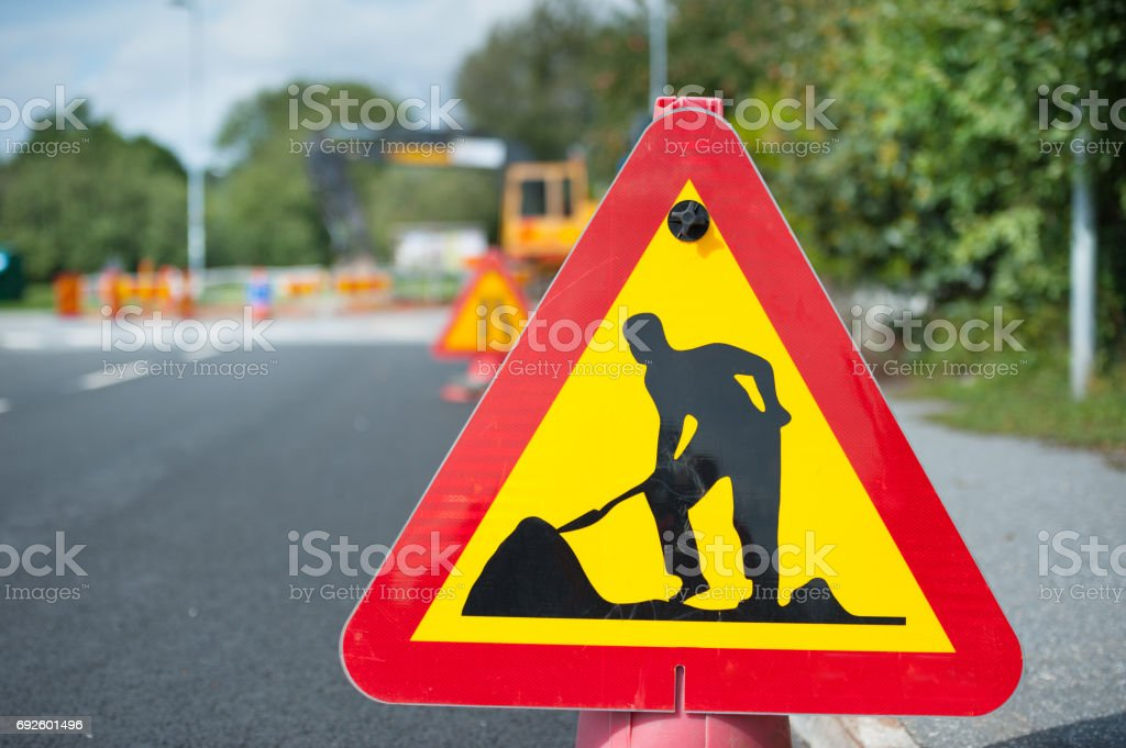 Road work sign and disturbance in background stock photo