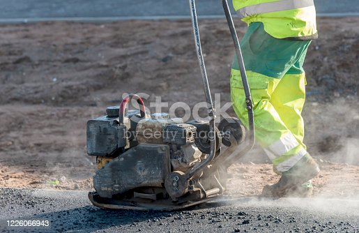worker on a road  construction site