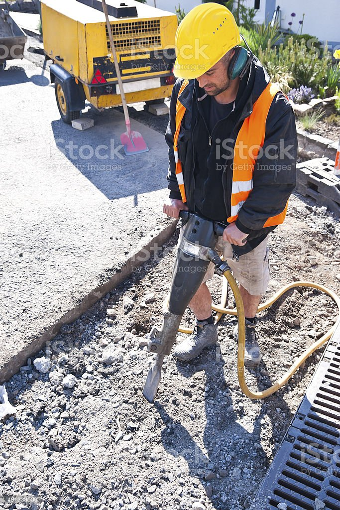 Road Worker with Jackhammer stock photo