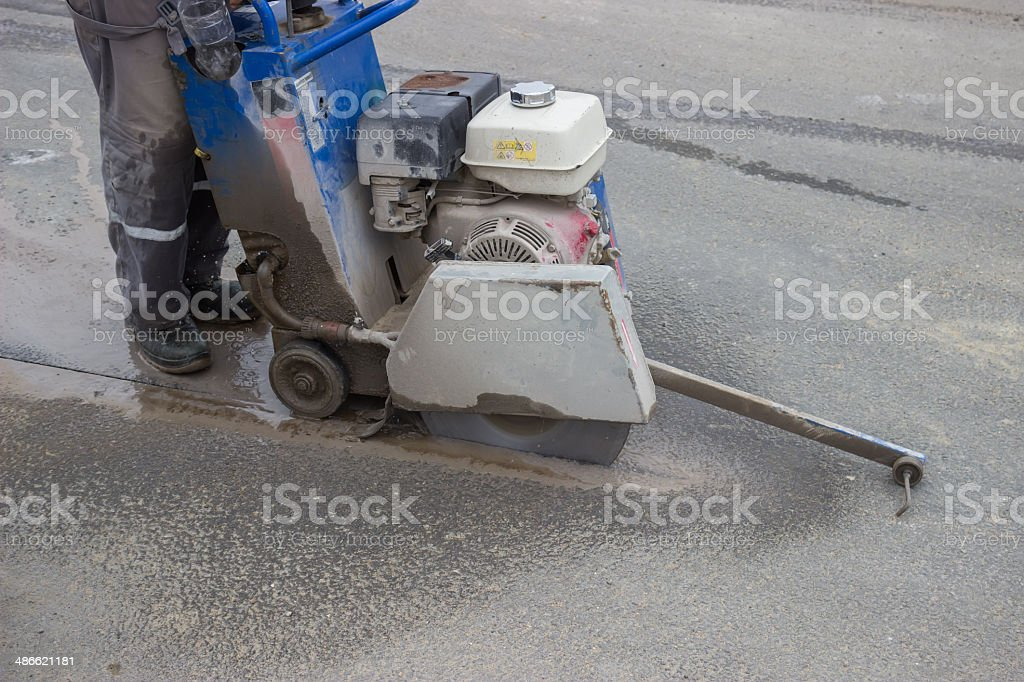 Road workers cutting asphalt road 4 stock photo