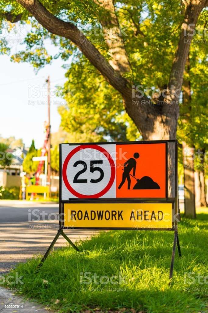 Road works 25 speed limit warning sign suburban side street royalty-free stock photo