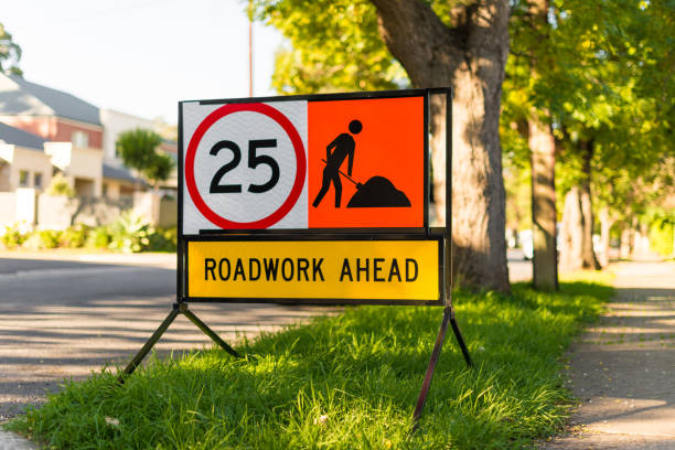 Road works 25 speed limit warning sign suburban side street stock photo