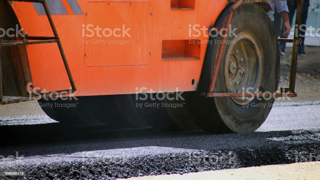 Road works, newly laid asphalt during road construction.