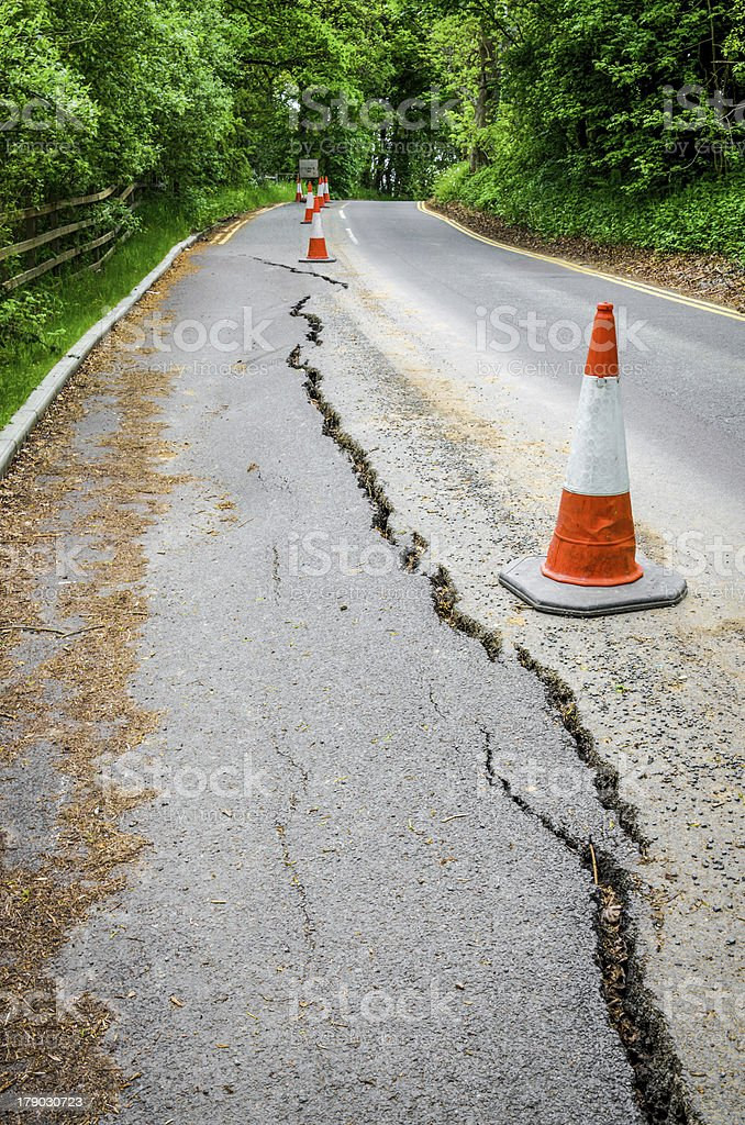 Road works on cracked tarmac from subsidence royalty-free stock photo