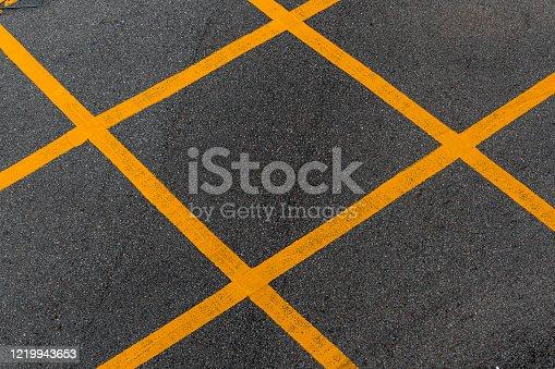 istock Road yellow marking on asphalt 1219943653