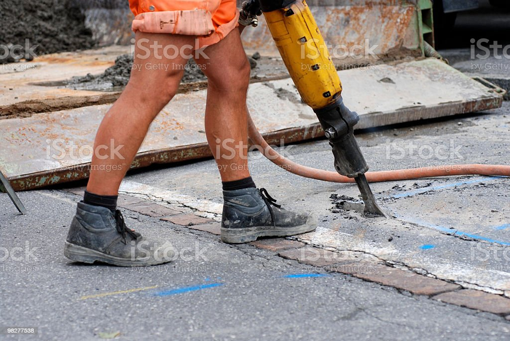 roadman with jackhammer at roadworks royalty-free stock photo