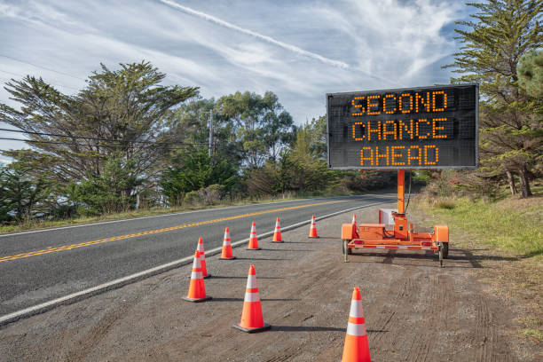 second chance ahead: roadside sign: trailer mobile warning sign parked by road with words for safety by orange cones - sorte foto e immagini stock