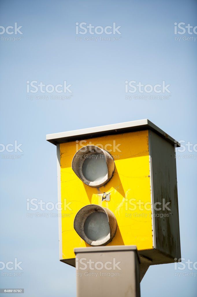 Roadside traffic calming speed camera with blue sky background stock photo