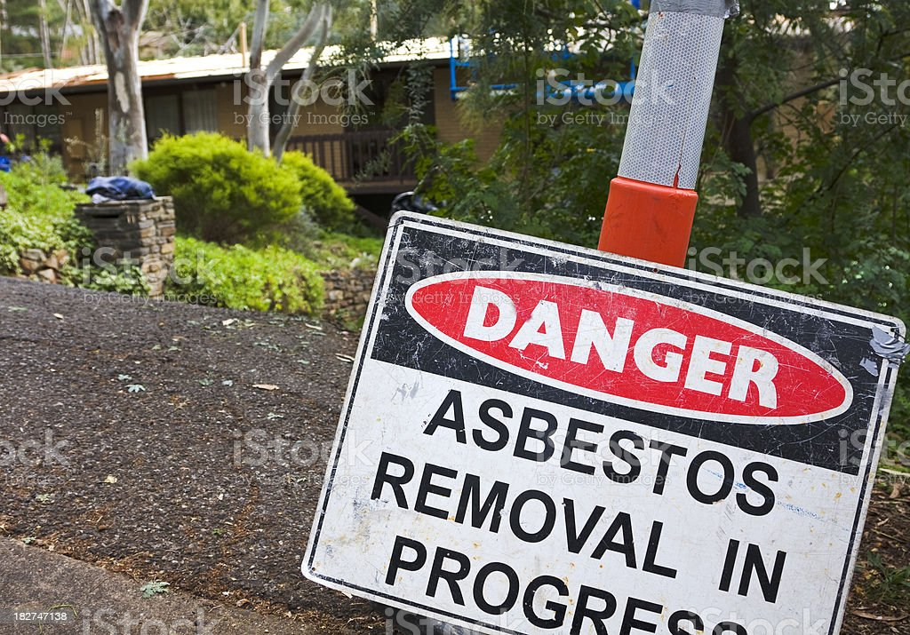 Roadside warning sign, asbestos removal in progress stock photo