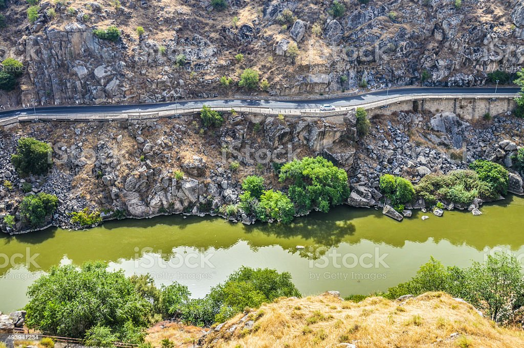 Roadside winding along the river stock photo
