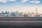 istock roadside with cityscape background 627024026
