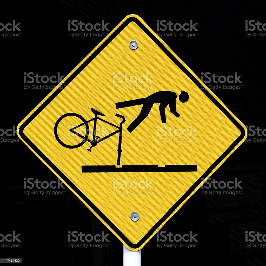 Roadsign warning cyclists of dangerous tram tracks royalty-free stock photo