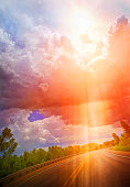 istock Roadtrip with dramatic sky and sunbeams 1249954002