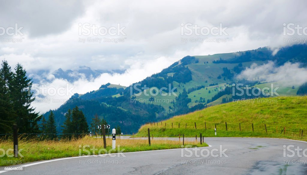 Roadway in the village of Boltigen with Swiss Alps at Jaun Pass of Fribourg canton stock photo