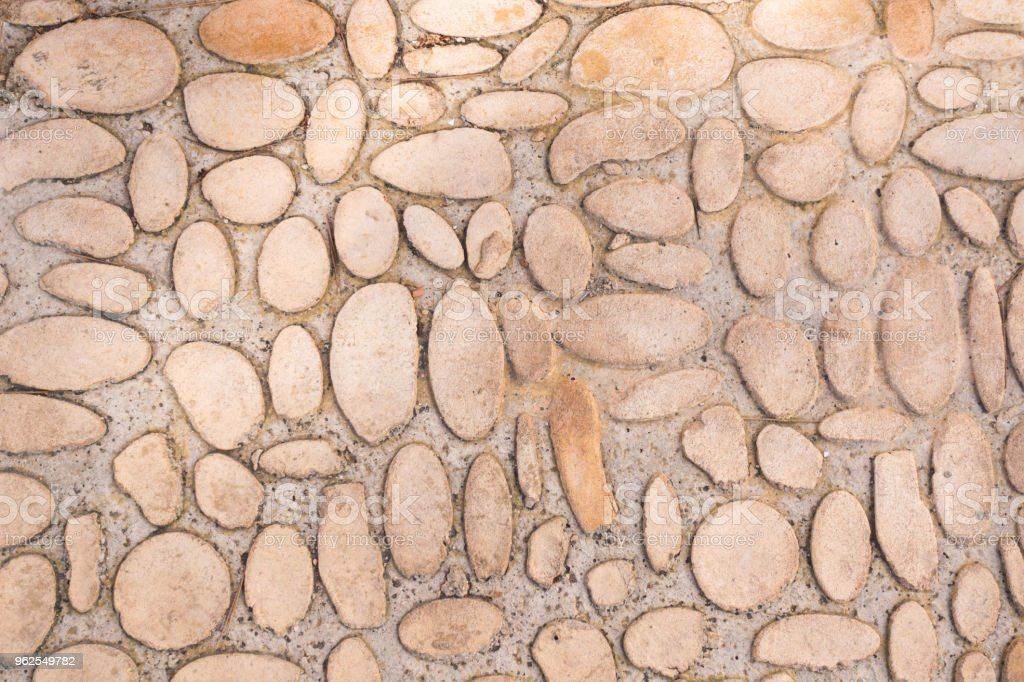 Roadway made of small round pebbles. Natural texture background. - Royalty-free Abstract Stock Photo