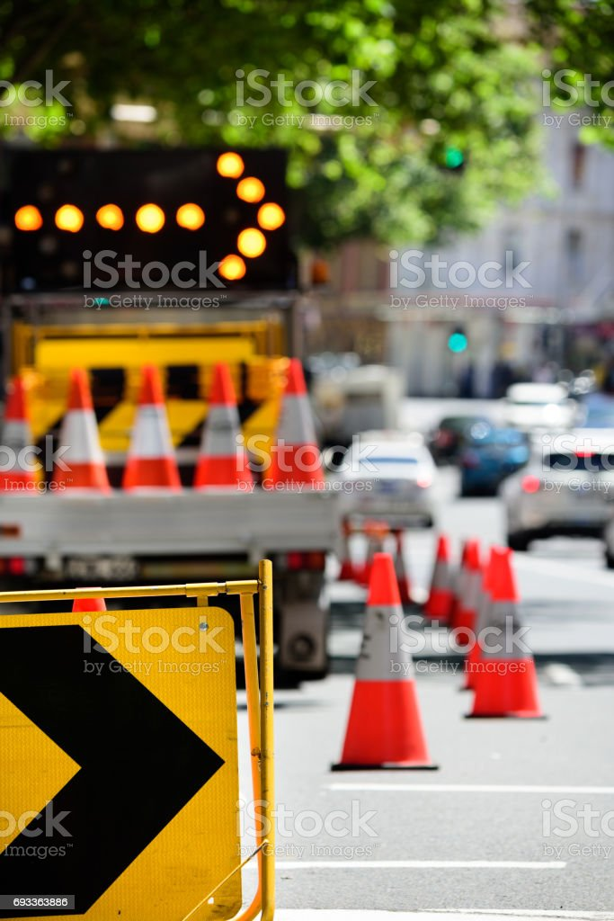 Roadwork cones and arrow stock photo