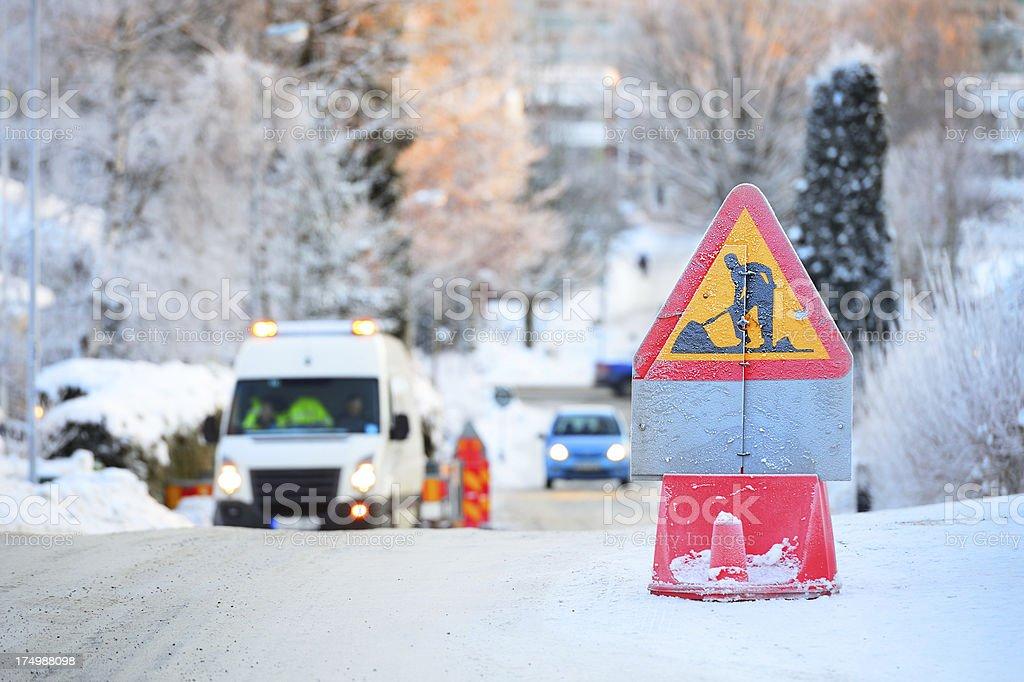 Roadwork on winter road royalty-free stock photo